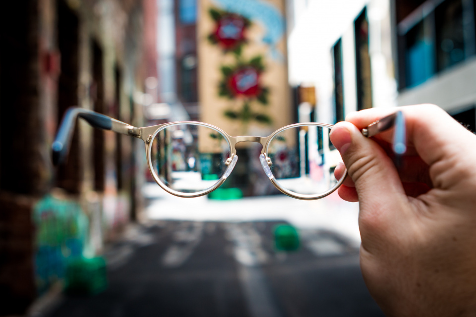 looking through glasses at a street