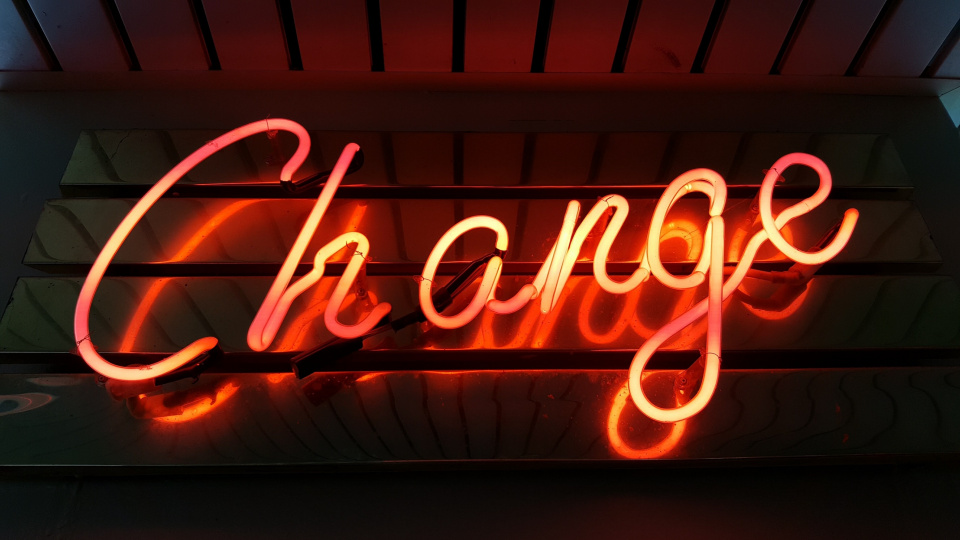 "Neon sign that says ""change"""