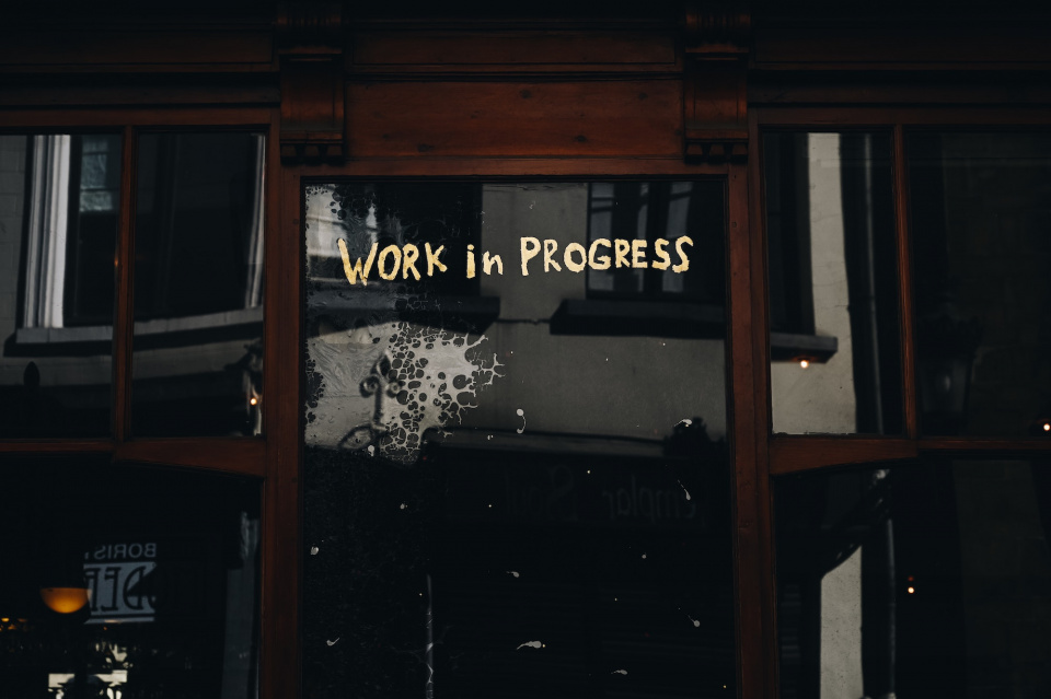 "sign that says ""work in progress"""