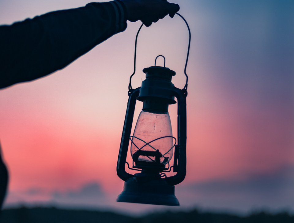 person holding a lantern